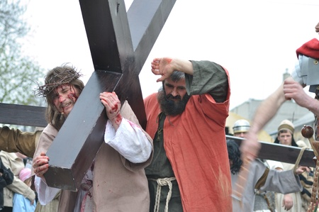 easter triduum: Gora Kalwaria, Poland - April 17, 2011 - Jesus carrying his cross, on the way to his crucifixion, during the street performances Mystery of the Passion.