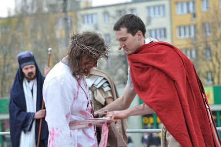 Gora Kalwaria, Poland - April 17, 2011 - Actors reenacting the crucifixion of Jesus Christ, during the street performances Mystery of the Passion. Stock Photo - 13022429