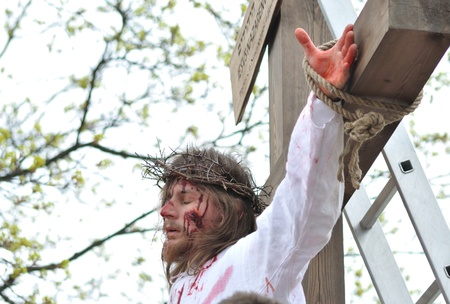 easter triduum: Gora Kalwaria, Poland - April 17, 2011 - Actor reenacting the crucifixion of Jesus Christ, during the street performances Mystery of the Passion.