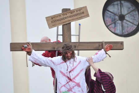 Gora Kalwaria, Poland - April 17, 2011 - Actors reenacting the crucifixion of Jesus Christ, during the street performances Mystery of the Passion. Stock Photo - 13022426