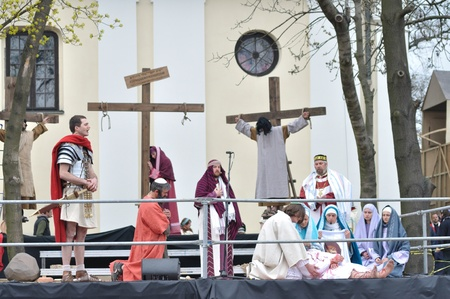 easter triduum: Gora Kalwaria, Poland - April 17, 2011 - Actors reenacting the removing a body of Jesus Christ from the cross, during the street performances Mystery of the Passion.