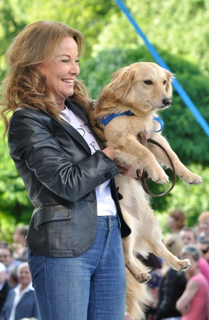 Warsaw, Poland - June 26, 2011 - Laura Lacz (actress) promotes social shares for adoption of animals - Love a doggie - during the Warsaw Fashion Street.  Stock Photo - 13154463
