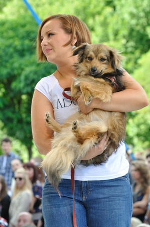 promotes: Warsaw, Poland - June 26, 2011 - Katarzyna Klich (pop singer) promotes social shares for adoption of animals - Love a doggie - during the Warsaw Fashion Street. Editorial