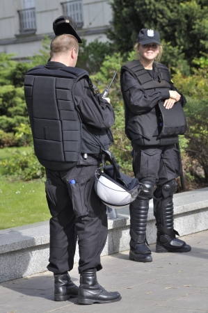 Warsaw, Poland - May 11, 2012 - Police officers in riot gear, protecting a parliament building, during a protest of the Solidarity trade union against the pension reform.