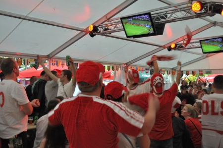 Warsaw, Poland - June 8, 2012 - Group of Poland fans watching football match on Television in pub, during the UEFA EURO 2012 Group A match against Greece.