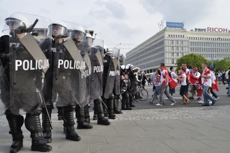 Warsaw, Poland - June 12, 2012 - Police troops protecting a route march of Russian fans towards the stadium during the Euro 2012 soccer championship Group A match between Poland and Russia. Stock Photo - 14277996