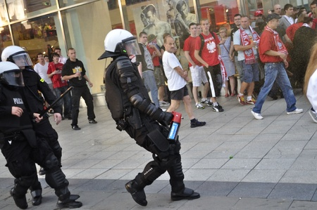 Warsaw, Poland - June 12, 2012 - Polish riot police react during football fans clash the Euro 2012 soccer championship Group A match between Poland and Russia. Editorial