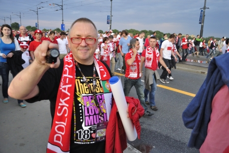 Warsaw, Poland - June 8, 2012 - Jerzy Owsiak (popular Polish journalist and social campaigner) walking among football fans after the UEFA EURO 2012 Group A match between Poland and Greece.