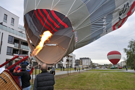 Warsaw, Poland - September 24, 2011 - Balloonists releases flame into the balloon during the First Balloon Fiesta on Mayor Cup Wilanow.