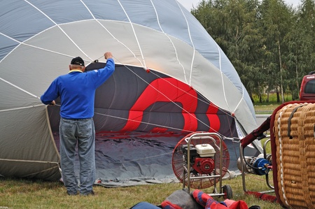 Warsaw, Poland - September 24, 2011 - Balloonist prepare balloon for ascension during the First Balloon Fiesta on Mayor Cup Wilanow.