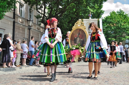 Lowicz, Poland - June 23, 2011 - Participants in the Corpus Christi procession, dressed in regional costumes.