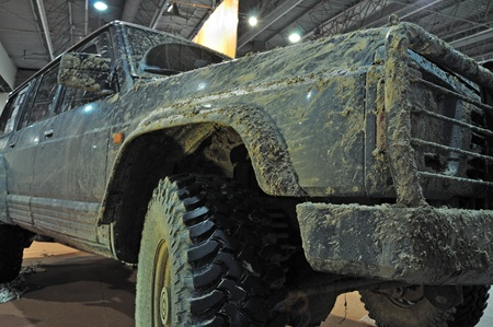 Warsaw, Poland - November 5, 2010 - Mud-covered Sport Utility Vehicle - on display at the Auto Show Poland.