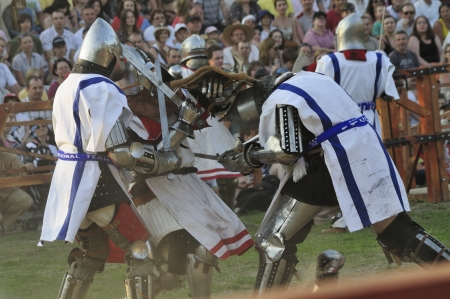 Warsaw, Poland - May 01, 2012 - Knights fighting in group battle during The International Festival of historical Reenactment of the Middle Ages