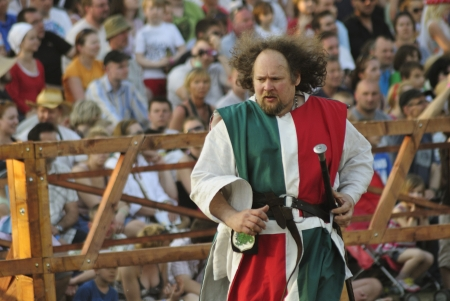 Warsaw, Poland - May 01, 2012 - A representative of the Italian team, runs on the battlefield during The International Festival of the Middle Ages