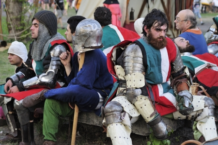 Warsaw, Poland - May 01, 2012 - Representatives of the Italian team are resting after the battle during the International Festival of the Middle Ages