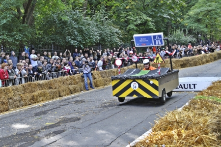 Warsaw, Poland - September 23, 2012 - Unidentified competitor rides his homemade vehicle during the Red Bull Soapbox Race. Stock Photo - 16224476