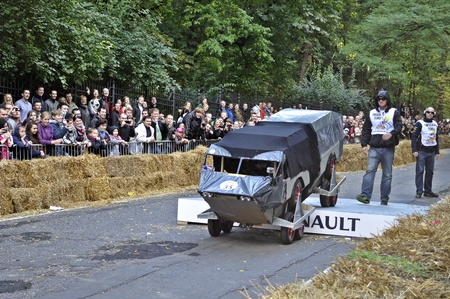 Warsaw, Poland - September 23, 2012 - Unidentified competitor rides his homemade vehicle during the Red Bull Soapbox Race. Stock Photo - 16224483