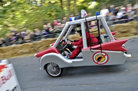 Warsaw, Poland - September 23, 2012 - Unidentified competitor rides his homemade vehicle during the Red Bull Soapbox Race. Stock Photo - 16224480