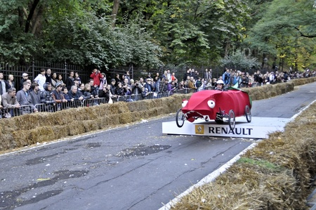 Warsaw, Poland - September 23, 2012 - Unidentified competitor rides his homemade vehicle during the Red Bull Soapbox Race. Stock Photo - 16224479