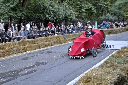 Warsaw, Poland - September 23, 2012 - Unidentified competitor rides his homemade vehicle during the Red Bull Soapbox Race. Stock Photo - 16224477