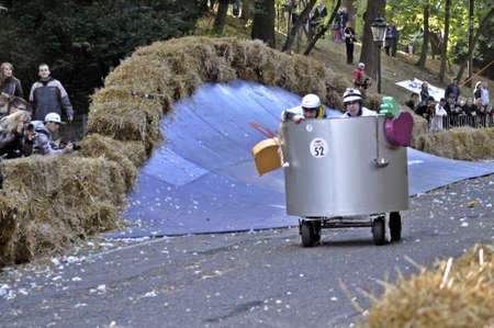 Warsaw, Poland - September 23, 2012 - Unidentified competitors rides his homemade vehicle during the Red Bull Soapbox Race. Stock Photo - 16224484