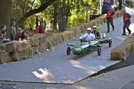 Warsaw, Poland - September 23, 2012 - Unidentified competitor rides his homemade vehicle during the Red Bull Soapbox Race. Stock Photo - 16348309