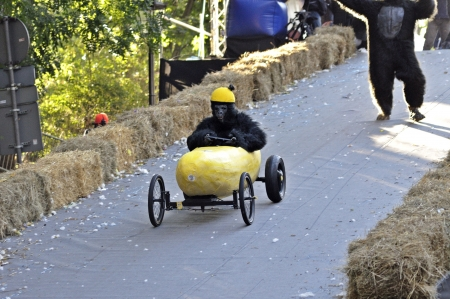 Warsaw, Poland - September 23, 2012 - Unidentified competitor rides his homemade vehicle during the Red Bull Soapbox Race. Stock Photo - 16348302
