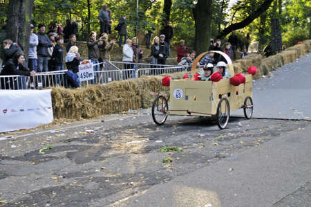 Warsaw, Poland - September 23, 2012 - Unidentified competitor rides his homemade vehicle during the Red Bull Soapbox Race. Stock Photo - 16348306