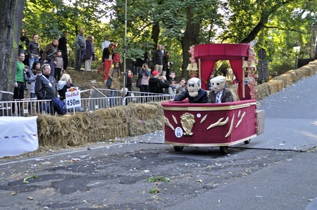 Warsaw, Poland - September 23, 2012 - Unidentified competitor rides his homemade vehicle during the Red Bull Soapbox Race. Stock Photo - 16348305