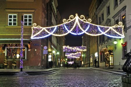Warsaw, Poland - December 14, 2012 - Christmas lights on the Old Town streets. Stock Photo - 16994360
