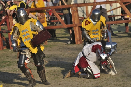 Warsaw, Poland - May 01, 2012 - Knights fighting in group battle during the International Festival of historical Reenactment of the Middle Ages - Battle of the Nations.