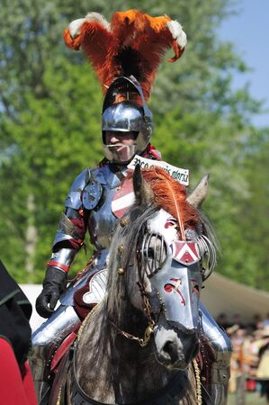 jousting: Warsaw, Poland - May 03, 2012 - Knight in jousting armor, mounted on horse during the International Festival of the Middle Ages - Battle of the Nations.