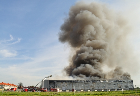 storage units: Wolka Kosowska, Poland - May 10, 2011 - Smoke rising from a raging fire in a China Mart storehouse. The fire burned 150 storage units covering nearly 2 hectares.
