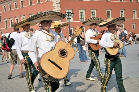 mexican folklore: WARSAW - AUGUST 27:  Mariachi band VALLARTA AZTECA from Puerto Vallarta - MEXICO, play mexican music - street parade during the International Folklore Festival WARSFOLK , on August 27, 2011 in Warsaw, Poland.
