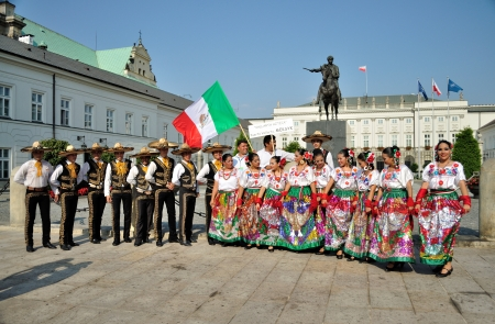 WARSAW - AUGUST 27: Folklore ensemble 'VALLARTA AZTECA' from Mexico in front of presidential palace in Warsaw - street parade during the International Folklore Festival 'WARSFOLK' , on August 27, 2011 in Warsaw, Poland.