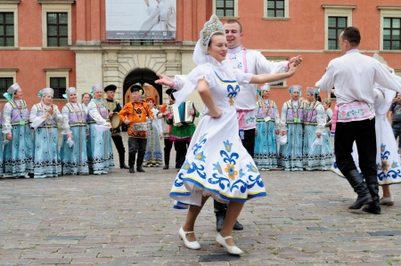 WARSAW - AUGUST 25: Folklore ensemble ROSSIJANA from Russia - street parade during the International Folklore Festival WARSFOLK on August 25, 2011 in Warsaw, Poland.