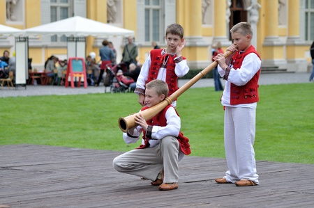 alphorn: WARSAW - SEPTEMBER 11: Playing the alphorn - show of the Silesian Gorals folklore, by the ensemble Kuznia Artystyczna, during of the Wilanow Days event on September 11, 2010 in Warsaw, Poland.