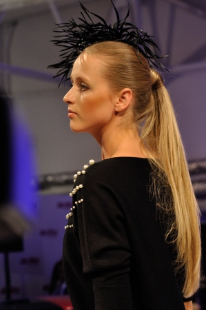 WARSAW - OCTOBER 22: A model walks the catwalk during a show by Michal Starost at BLACKBERRY & PLAY WARSAW FASHION WEEKEND on October 22, 2011 in Warsaw, Poland.