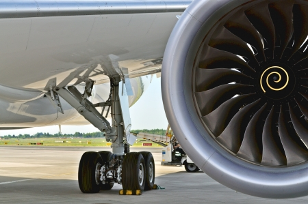 WARSAW - AUGUST 4  Landing gear and engine of the Boeing 787 Dreamliner, while parked at Chopin Airport on August 4, 2013 in Warsaw, Poland  Editorial