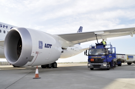 WARSAW - AUGUST 4  New Boeing 787 Dreamliner of the LOT Polish Airlines - receiving fuel from tanker truck at Chopin Airport on August 4, 2013 in Warsaw, Poland