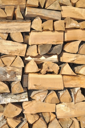 firewood background - chopped firewood on a stack photo