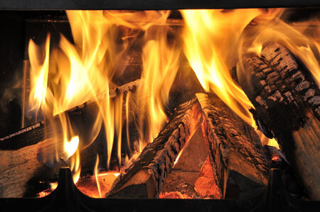 smoke stack: burning firewood in the fireplace Stock Photo