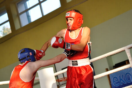 onrush: Warsaw, Poland - October 01, 2011: Young boxers fighting during the XI-th junior boxing tournament - Cup of Mayor of the municipality Raszyn. Editorial
