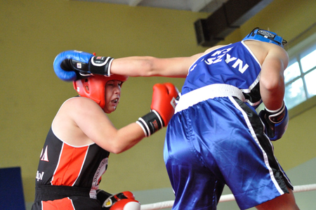 match head: Warsaw, Poland - October 01, 2011: Young boxers fighting during the XI-th junior boxing tournament - Cup of Mayor of the municipality Raszyn. Editorial