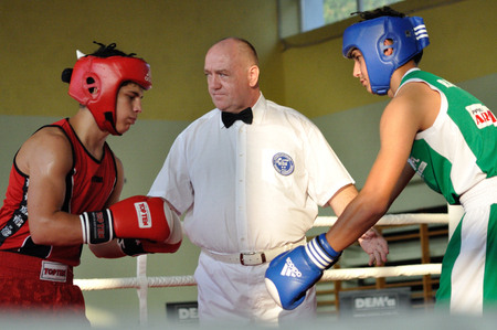 Warsaw, Poland - October 01, 2011: Boxing judge and young boxers before fight during the XI-th junior boxing tournament - Cup of Mayor of the municipality Raszyn.