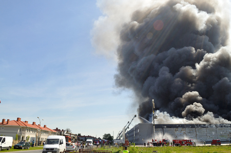 misadventure: Wolka Kosowska, Poland - May 10, 2011 - Smoke rising from a raging fire in a China Mart storehouse. The fire burned 150 storage units covering nearly 2 hectares.