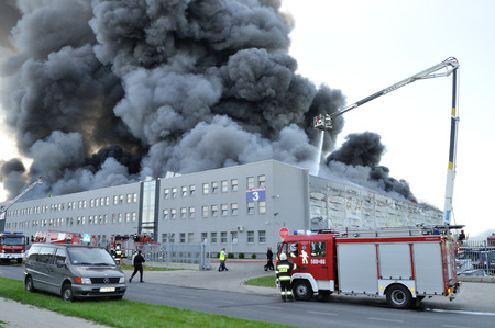 Wolka Kosowska, Poland - May 10, 2011 - Firefighters extinguish a raging fire in a China Mart storehouse. Editorial