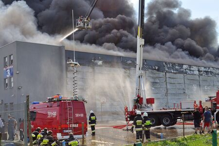 mart: Wolka Kosowska Poland May 10 2011 Firefighters extinguish a raging fire in a storehouse Mart China. Editorial