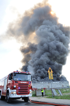 extinguish: Wolka Kosowska, Poland - May 10, 2011 - Firefighters extinguish a raging fire in a China Mart storehouse. Editorial