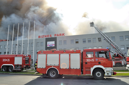 Wolka Kosowska, Poland - May 10, 2011 - Firefighters extinguish a raging fire in a China Mart storehouse.